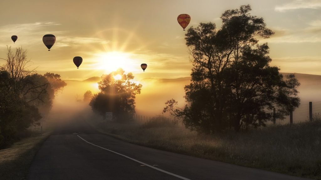 Hot Air Balloons Drifting over a Street