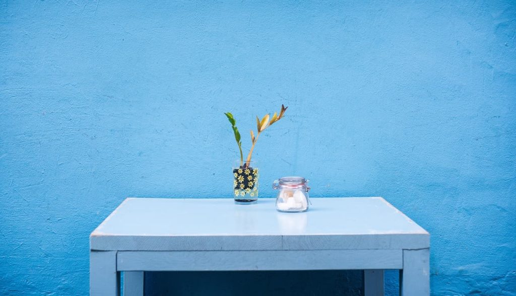 Minimal furniture with a blue wall