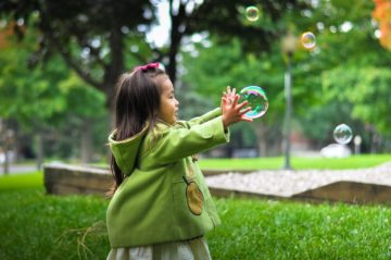 Child chasing a bubble